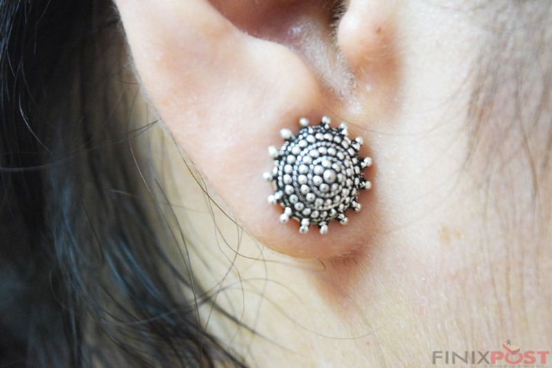 statement earrings   how to look thin