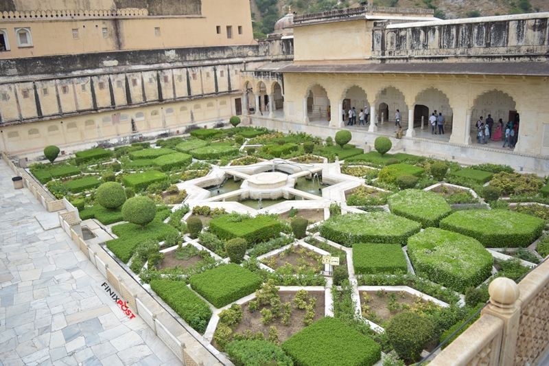 beautiful garden and fountain at amber fort jaipur