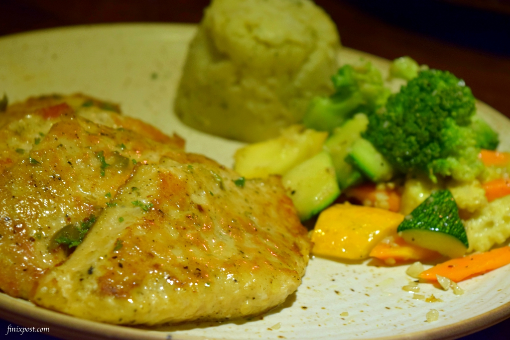 Grilled fish with lemon caper sauce at wolfgang and company delhi
