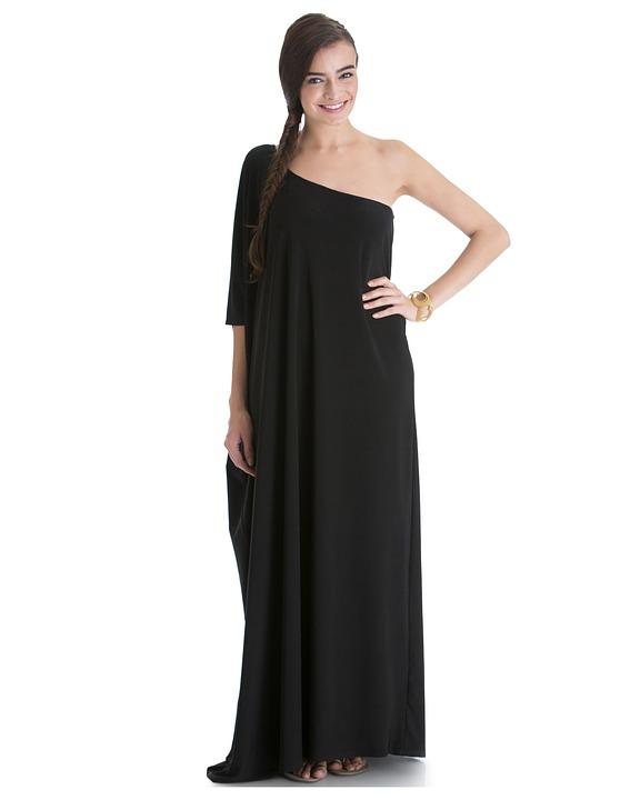 wearing loose black dress